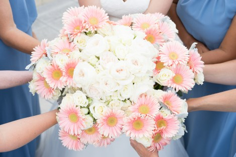 Bridesmaids show off their flowers during an Old Town Alexandria wedding.