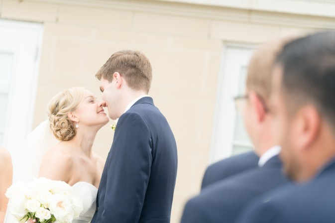 A bride and groom kiss on the terrace of the Kimpton Lorien Hotel and Spa.