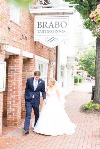 A bride and groom walk along King Street in Old Town Alexandria