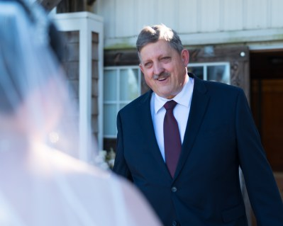 Father of the bride sees his daughter for the first time before a ceremony at Hermitage Hill Farm in Waynesboro, Virginia.
