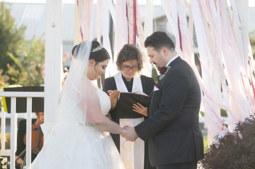A bride and groom pray during their ceremony at Hermitage Hill Farm in Waynesboro, Virginia.