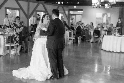 A bride and groom's first dance during their wedding at Hermitage Hill Farm in Waynesboro, Virginia.