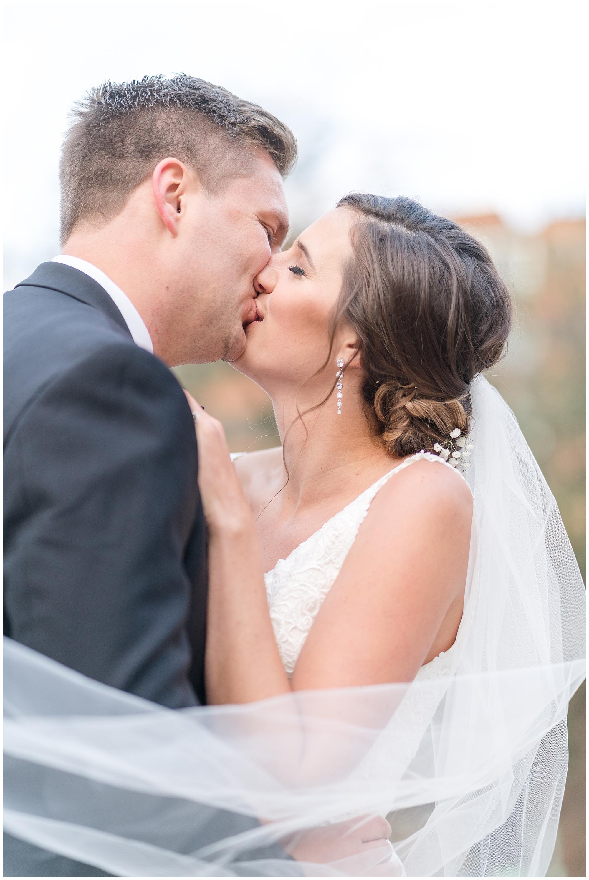 A bride and groom kiss at DuPont Circle during their Washington DC wedding.