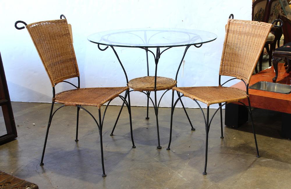a french bistro style wrought iron patio set