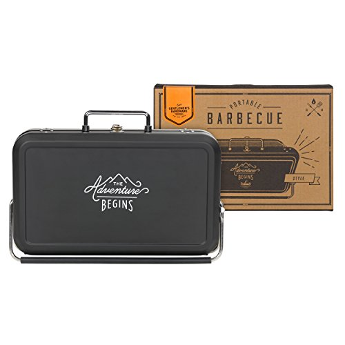 """As the title suggests, the Gentleman's Hardware Small Suitcase Style BBQ is intelligently disguised as a suitcase so you can carry it wherever the adventure takes you as a true gent. It has a classic black casing with the motto """"The Adventure Begins"""" printed on either side."""