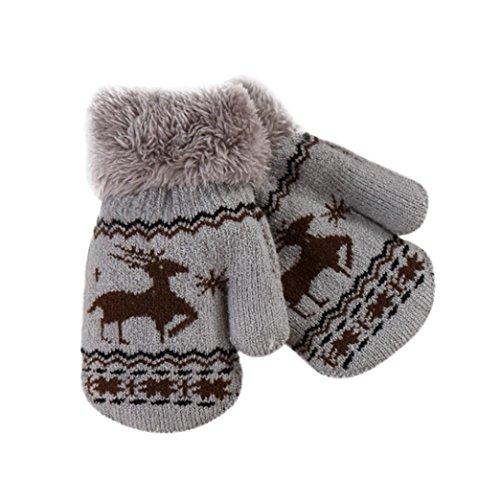 Fami-Cervi svegli di Natale addensano i bambini caldi dell'infantile dei ragazzi dei guanti caldi di...