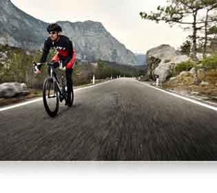 Nikon D500 DSLR photo of a bike rider on the road highlighting Nikon's processing power