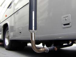 The Camco Gen-turi RV Generator Exhaust Venting System attaching to a RV generator exhaust pipe