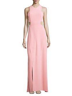 21D1OetKjAL Sultry side and back cutouts define crepe halter gown. Halter neckline. Sleeveless. Front slit. Concealed back zip closures.