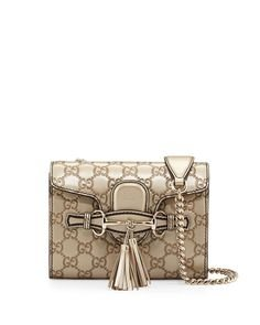 """315ZVkNO4vL The mini Emily chain shoulder bag multifunctions as both a cross body and a shoulder bag and has just enough room for the necessities Golden Beige Metallic guccissima leather with detail Light fine gold hardware Leather tassels and horsebit details Natural cotton linen lining Double chain straps with leather shoulder panel and 23"""" drop Interior open pocket Slide flap closure with embossed gucci trademark detail"""