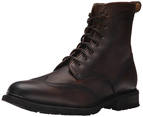 Ankle-high boot with wingtip styling featuring pinking and broguing Leather laces with grommets Full shearling lining