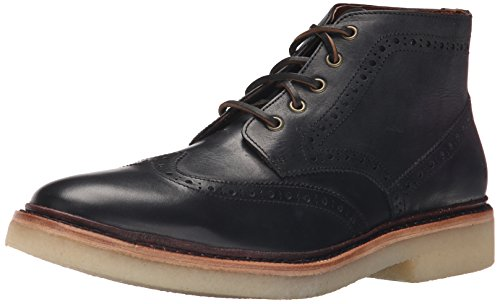 Wingtip boot featuring brogue perforations and rawhide lacing Crepe outsole