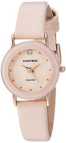 41f3DmhuENL Curved wall-to-wall mineral crystal lens; blush pink glossy dial with genuine diamond at 12; rose gold-tone hands and markers Blush pink leather strap with buckle closure Japanese-quartz Movement