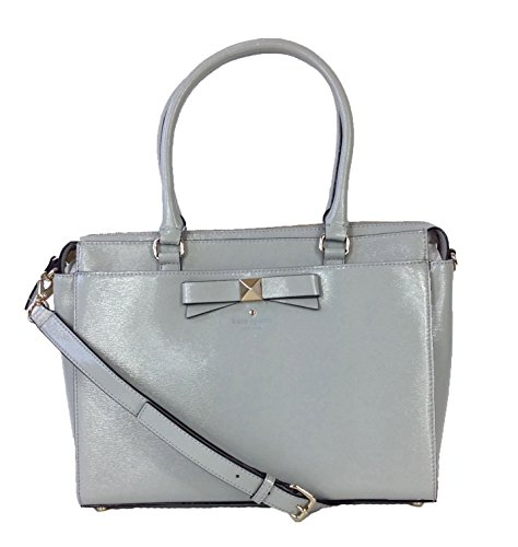 Convertible satchel in textured patent leather . Front slip pocket w bow applique and embossed kate spade logo. Top handle. Removable, adjustable crossbody strap. Metal feet