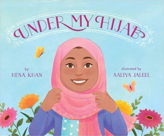 A book cover showing a smiling brown woman.  She is wearing a pink Hijab, a blue shirt with white hearts and a purplish blue sweater.