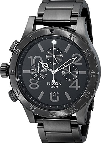 51B2sCm8dAL Brushed stainless steel watch featuring engraved bezel, left-hand pushers and crown, and three chronograph subdials 48 mm stainless steel case with mineral dial window Japanese quartz movement with analog display