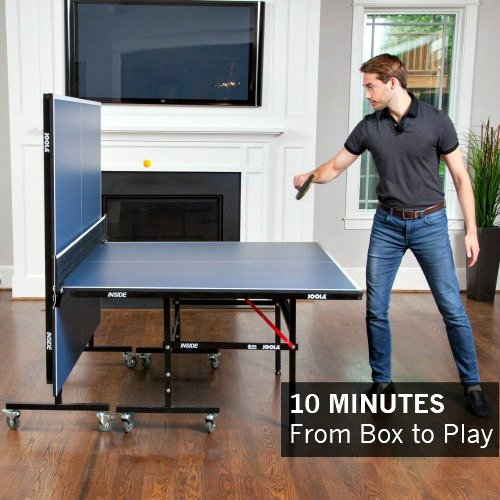 Man Cleaning Ping Pong Table