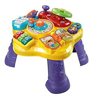 The Magic Star Learning Table by VTech features six fun activities in English and Spanish that encourage your child to explore and learn. Turn the steering wheel to drive the bear around the activity table, flip the book page to hear nursery rhymes a...