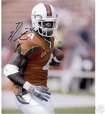 Amazon.com: Devin Hester Autographed Miami Hurricanes (Orange Jersey) 8x10  Photo: Sports Collectibles