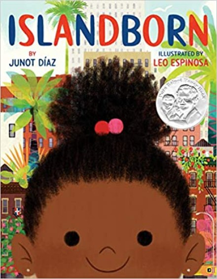 a book cover image showing the large face of a brown-skinned little girl.  She is smiling brightly with no teeth showing.  Behind her are apartment buildings, pink and red flowers, and trees.
