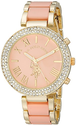 51pUX%2B9BZnL Gold-tone watch featuring sparkling bezel and pink dial with applied logo and Roman numeral indices 40 mm metal case with glass dial window Quartz movement with analog display