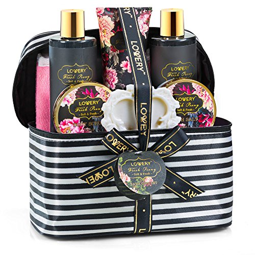 Home Spa Gift Basket. This gift basket has a makeup bag as the base. Love the pink, white and black theme that is consistent.