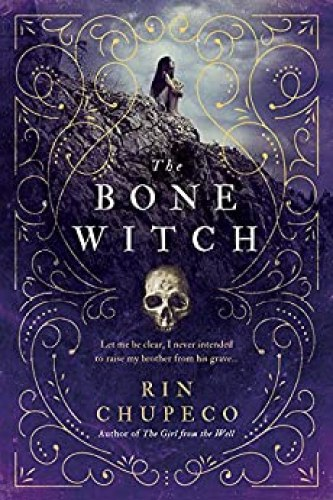 book cover woman on rocks with skull the bone witch