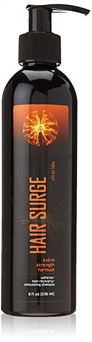 hair surge hair loss shampoo in a black and orange bottle