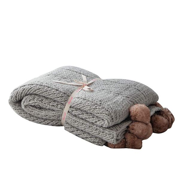 Farmhouse Fall Decor Ideas - Grey Knitted Throw Blanket with brown faux fur pom poms