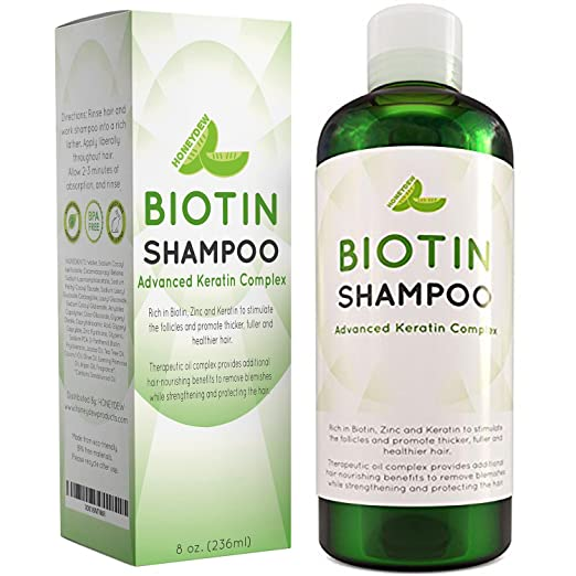 Biotin shampoo for hair loss in a green and white bottle