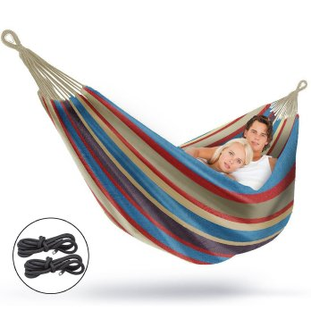 Striped outdoor hammock with couple inside