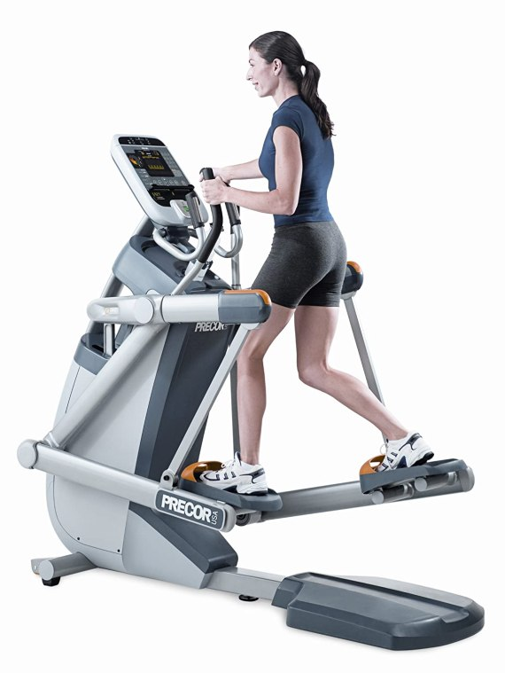 Girl riding the Precor AMT100i