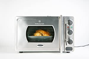 Looks like a standard oven but with a seal in lever and a pressure release valve