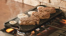 Cooking steaks on a stove top grill pan
