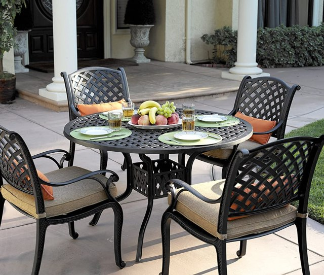 Amazon Com Darlee N Au Cast Aluminum  Piece Dining Set With Seat Cushions And  Inch Round Dining Table Antique Bronze Finish Garden Outdoor