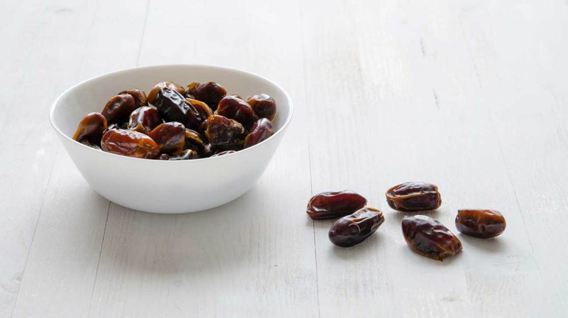 Dates in a White Bowl