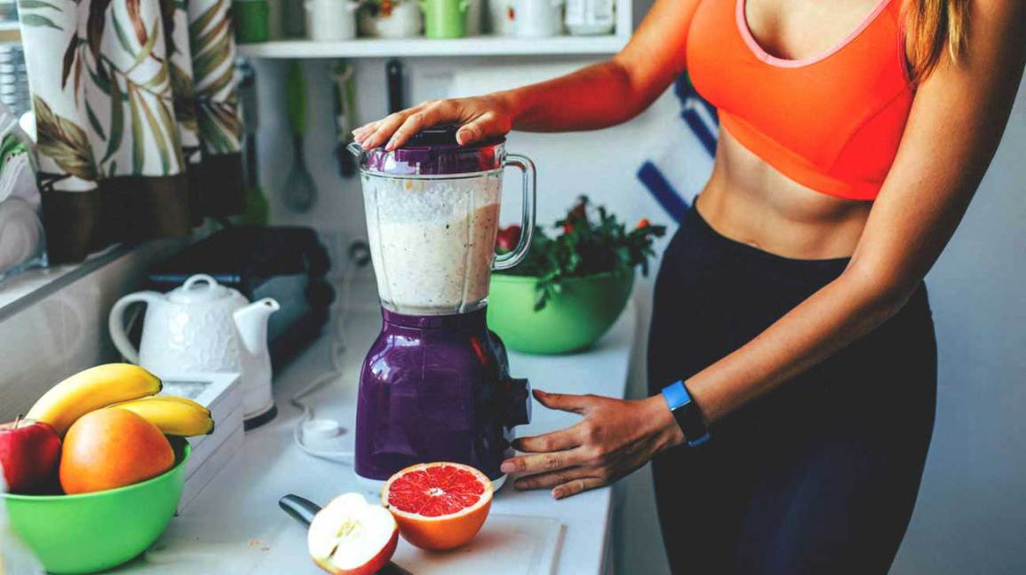 Fit Woman Making Smoothie