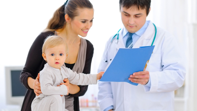 Mother with toddler speaking with doctor
