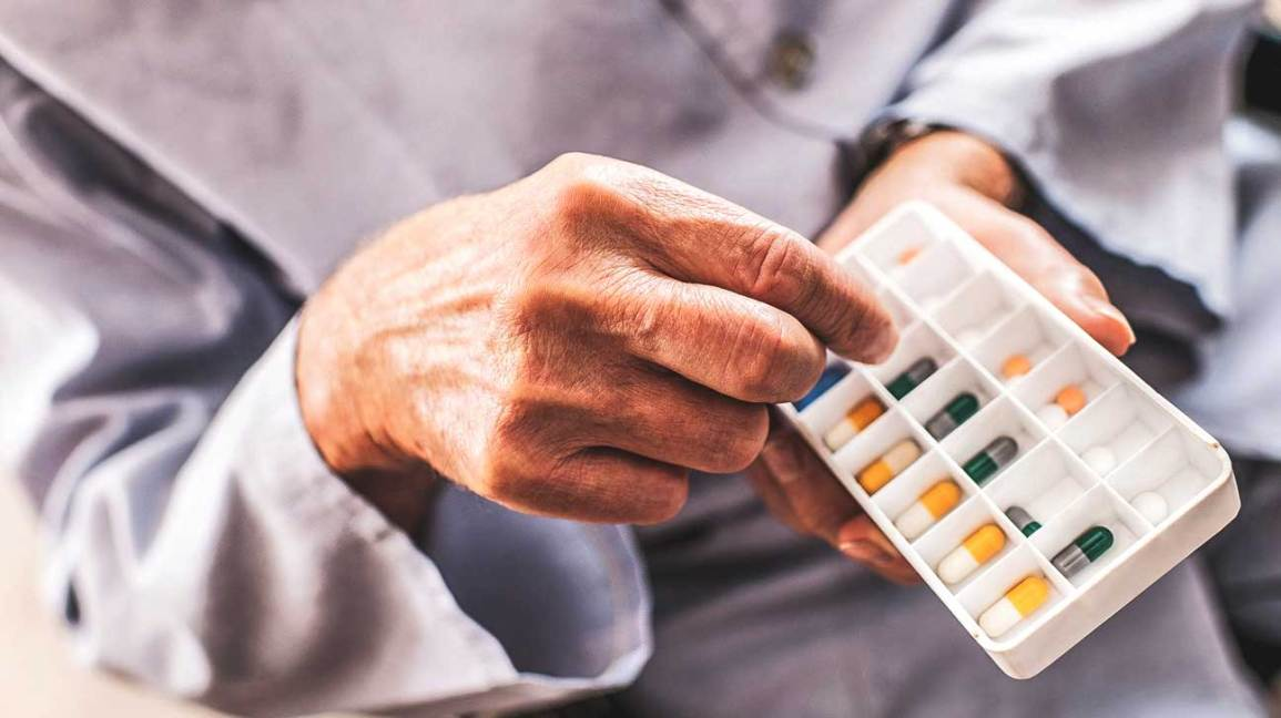older adult taking medication