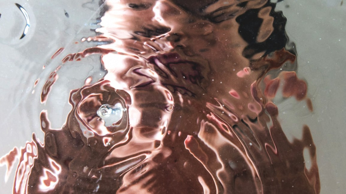 reflection of face in water