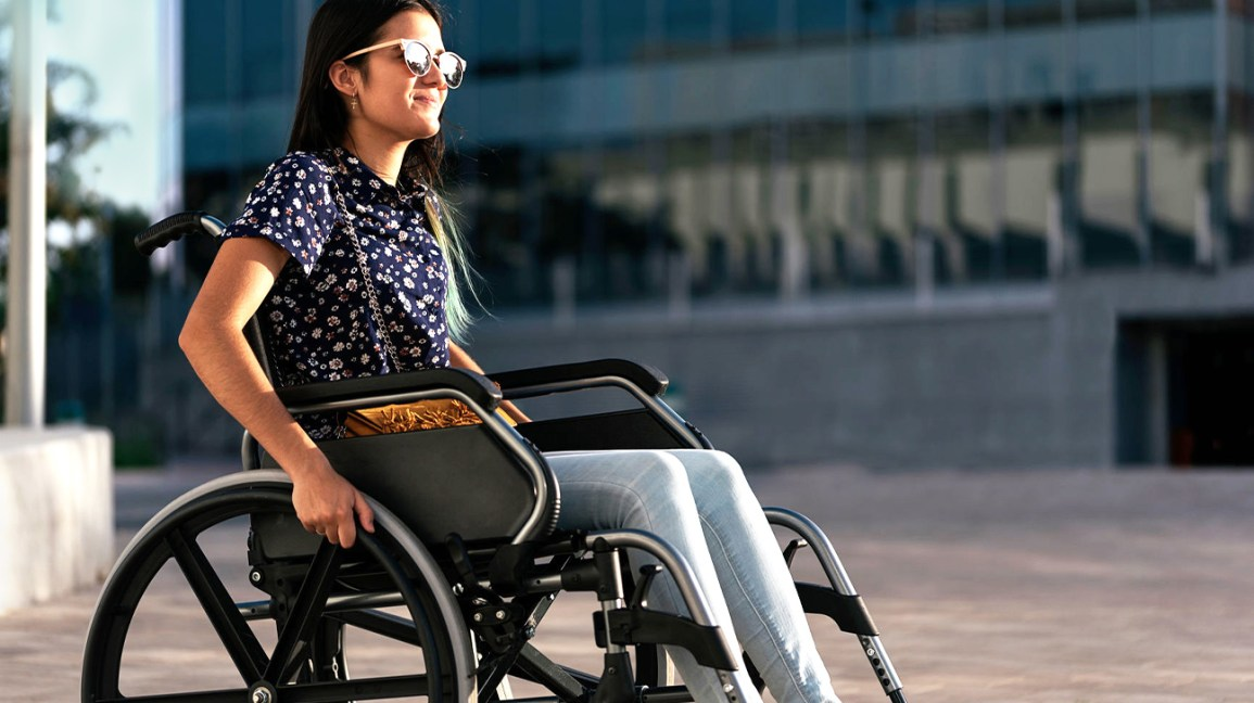 woman sitting in a wheelchair in the sun