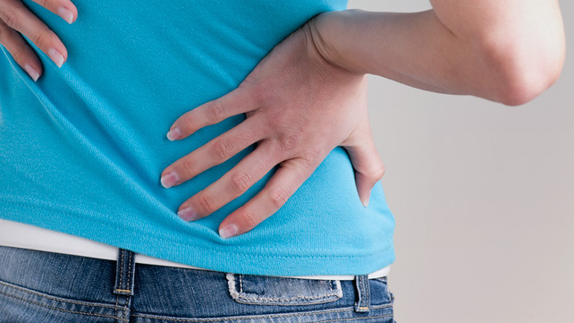 woman experiencing ibs back pain