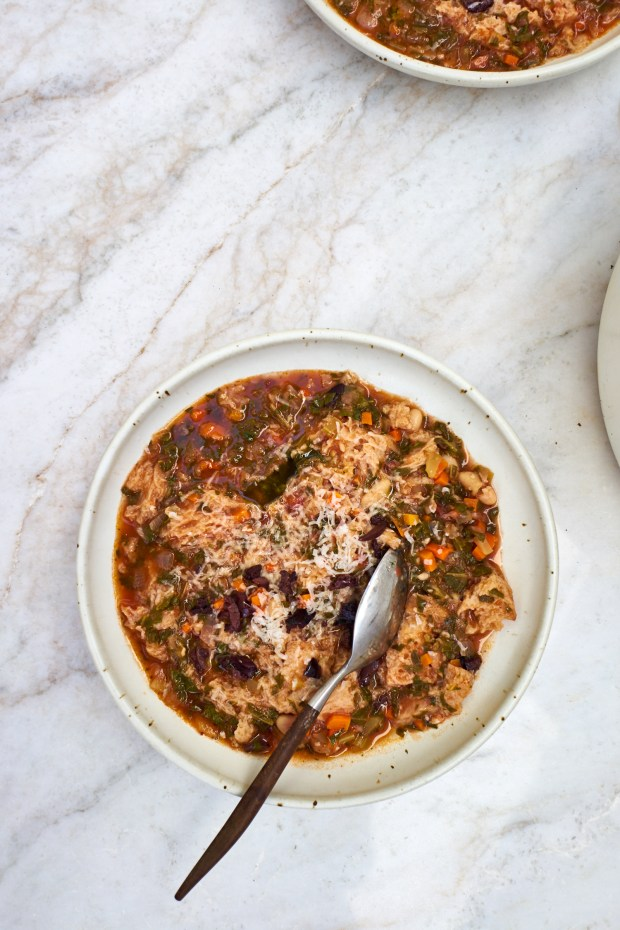 Ribollita, a beautifully thick Tuscan stew with dark greens, lots of beans, vegetables, olive oil, and thickened with day-old bread