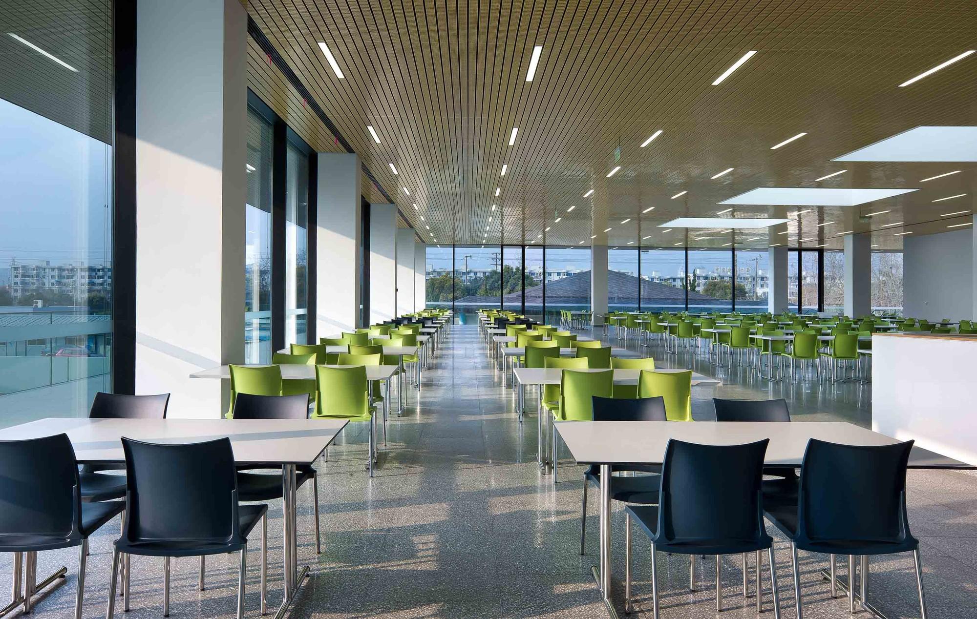 Gallery of Roche Canteen  EXH Design  16