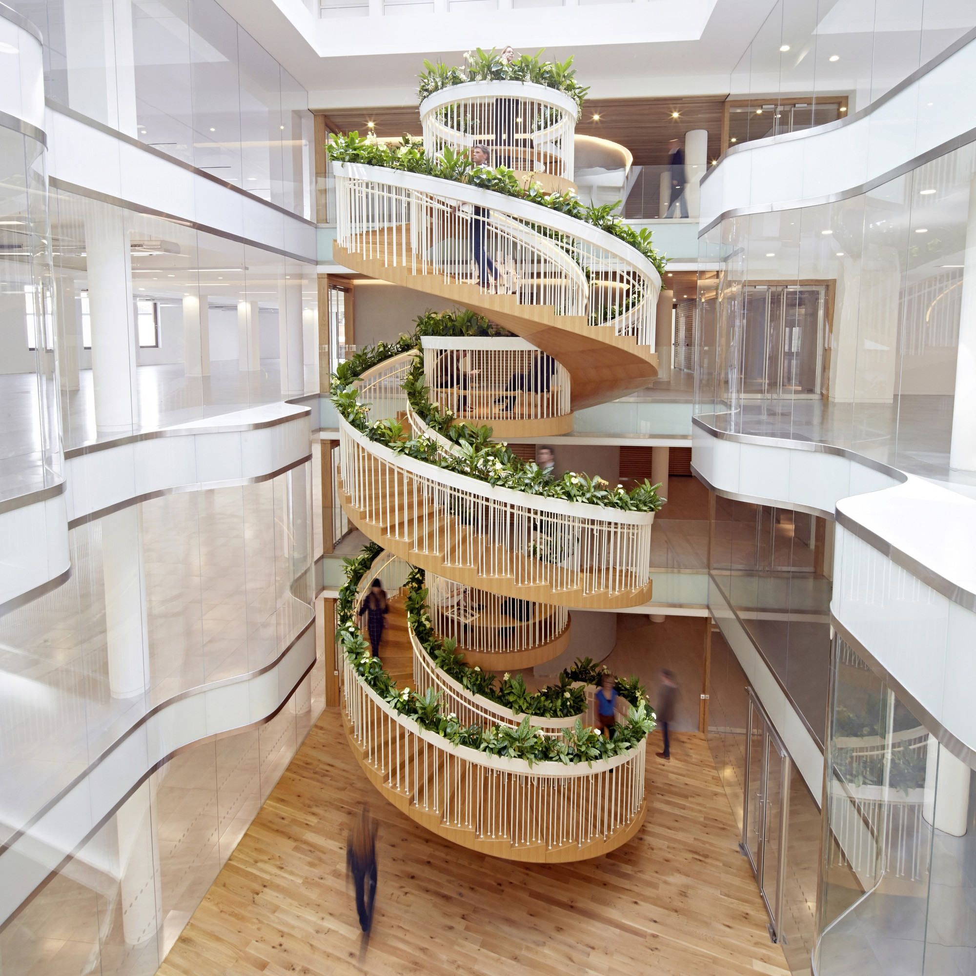 Living Staircase Paul Cocksedge Archdaily | Staircase Design For Commercial Buildings | Cylindrical Glass | Enclosed | Beautiful | Central Staircase | Sleek