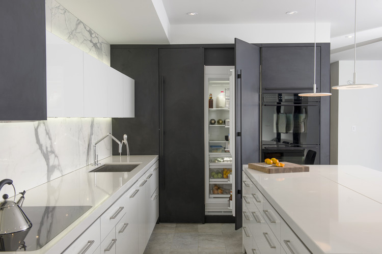 """""""Hide and Seek"""" designed by Dovide Secter, Secter Design Limited, Winnipeg, MB. First Place award for Contemporary style, 2013-2014 Kitchen Design Contest. Image Courtesy of Sub-Zero and Wolf"""