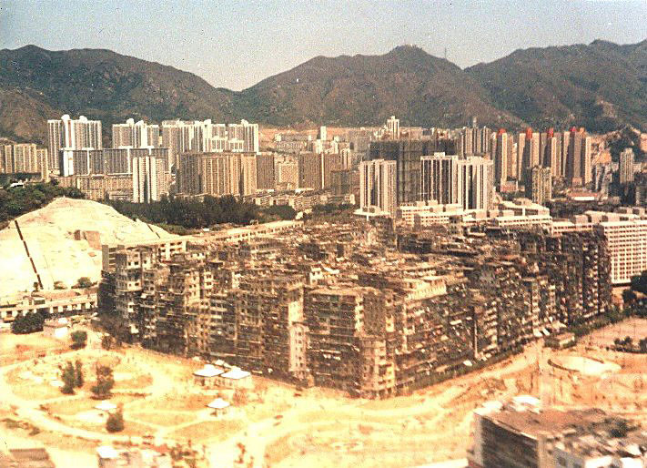 Kowloon walled city in 1989. Image © <a href='https://commons.wikimedia.org/wiki/File:Aerial_view_of_Kowloon_Walled_City_in_Hong_Kong_on_1989-03-27.jpg'>Wikimedia user Jidanni</a> licensed under <a href='https://creativecommons.org/licenses/by-sa/3.0/deed.en'>CC BY-SA 3.0</a>