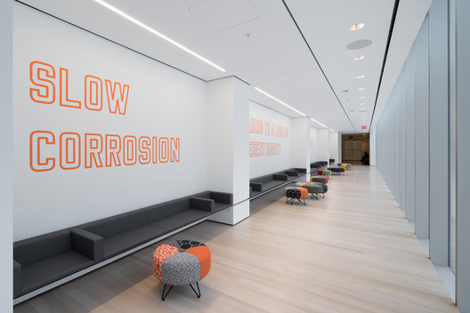View of The Louise Reinhardt Smith Gallery, including Lawrence Weiner's SLOW CORROSION LEADING TO A LOSS OF INHERENT DIGNITY OF THE OBJECT AT HAND (1985). Image © Iwan Baan