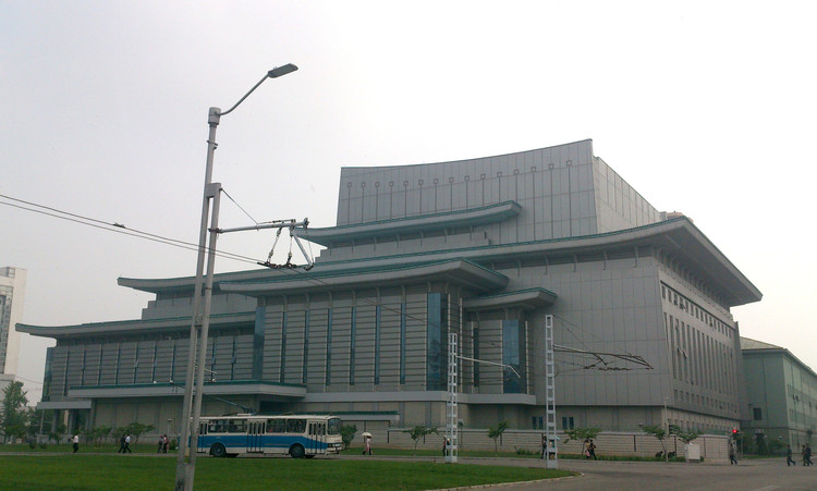 One of Pyongyang's theaters, utilizing the Korean Giwa roof style. Image © Alex Davidson