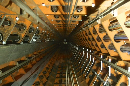 Illuminated elevator shaft at the Atomium in Brussels, Belgium. Designed by André Waterkeyn and architects André and Jean Polak. Image © Thomas Schielke